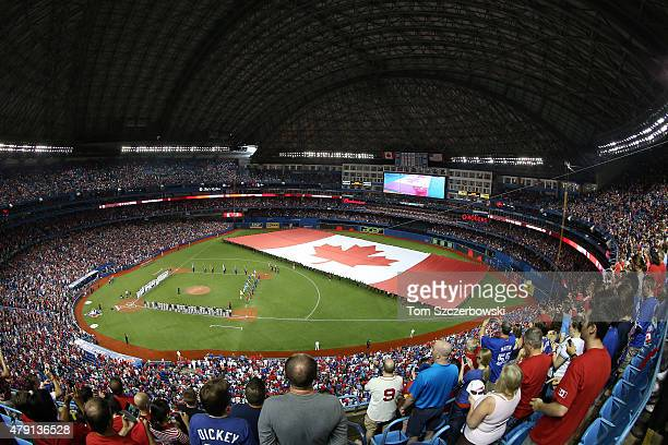 A large Canadian flag is unveiled on the field on Canada Day before the start of the Toronto Blue Jays MLB game against the Boston Red Sox on July 1...