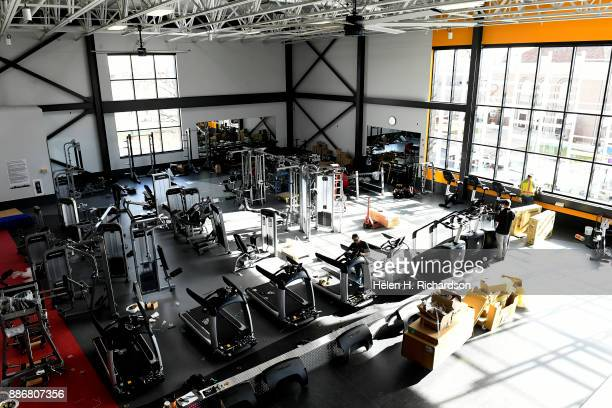 DENVER CO NOVEMBER 29 A large cardio and fitness center with lots of natural light is one of the many amenities at the new Carla Madison Recreation...