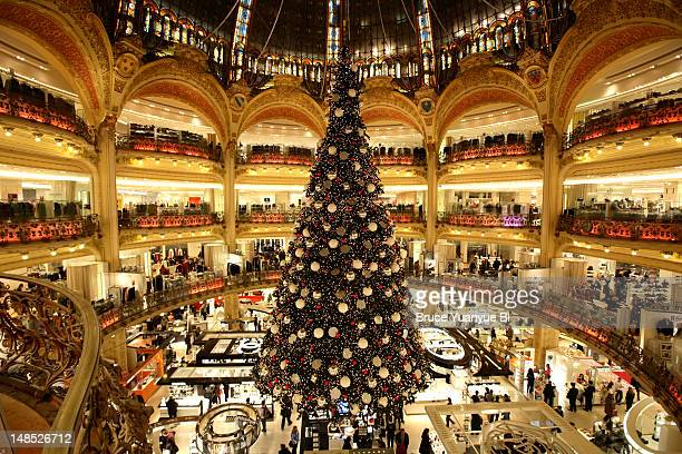 Large Christmas tree decorating Galeries Lafayette store floor.