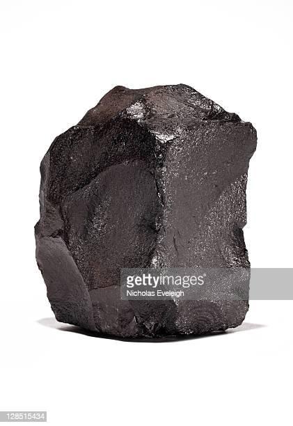 Large chunk of black coal on a white background