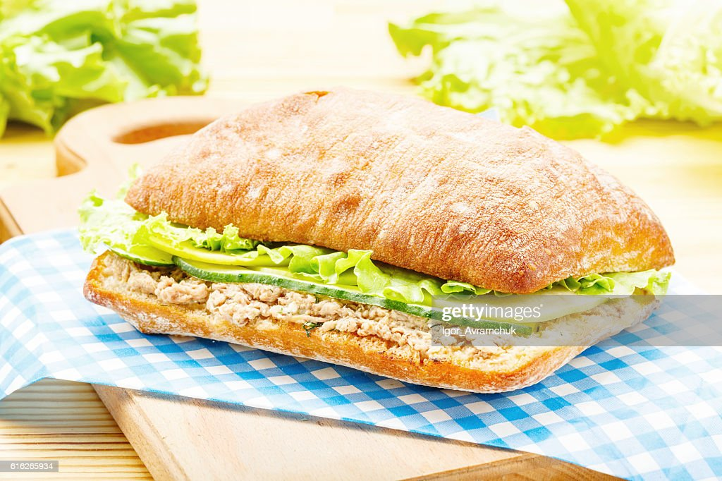 Large ciabatta sandwich with tuna, green, apple and cucumber : Stock Photo