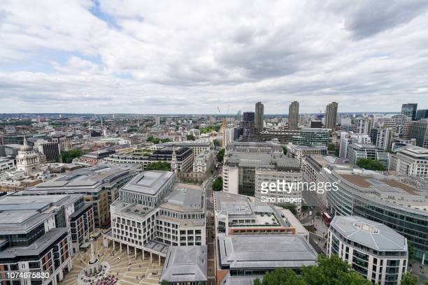 large clouds over densely populated city, england, uk - image stock pictures, royalty-free photos & images