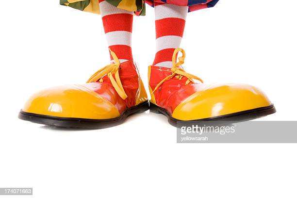 large clown feet in yellow and red shoes - big foot stock photos and pictures