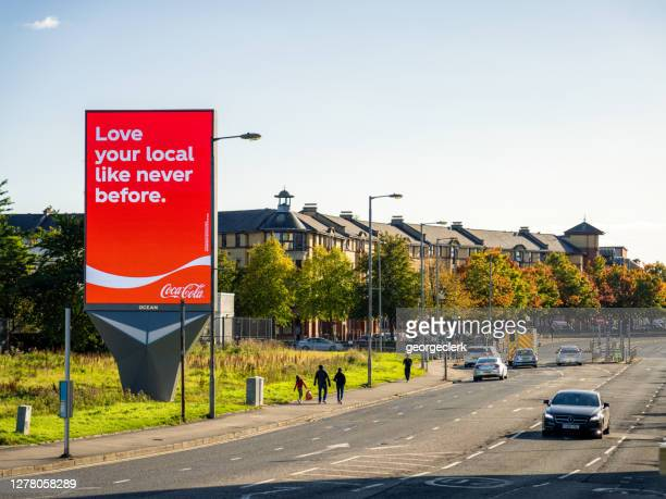 large coca cola advert on city street - slogan stock pictures, royalty-free photos & images