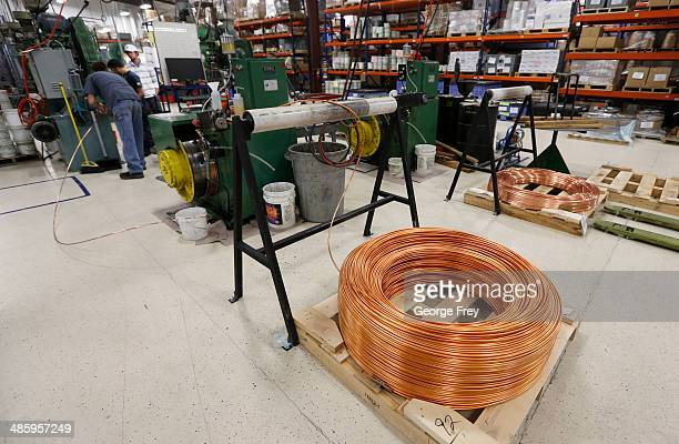 A large coil of copper wire sits on the floor waiting to be manufactured into bullets at Barnes Bullets on April 2014 in Mona Utah Barnes says it...
