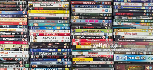 Large collection of movie DVDs, stacked