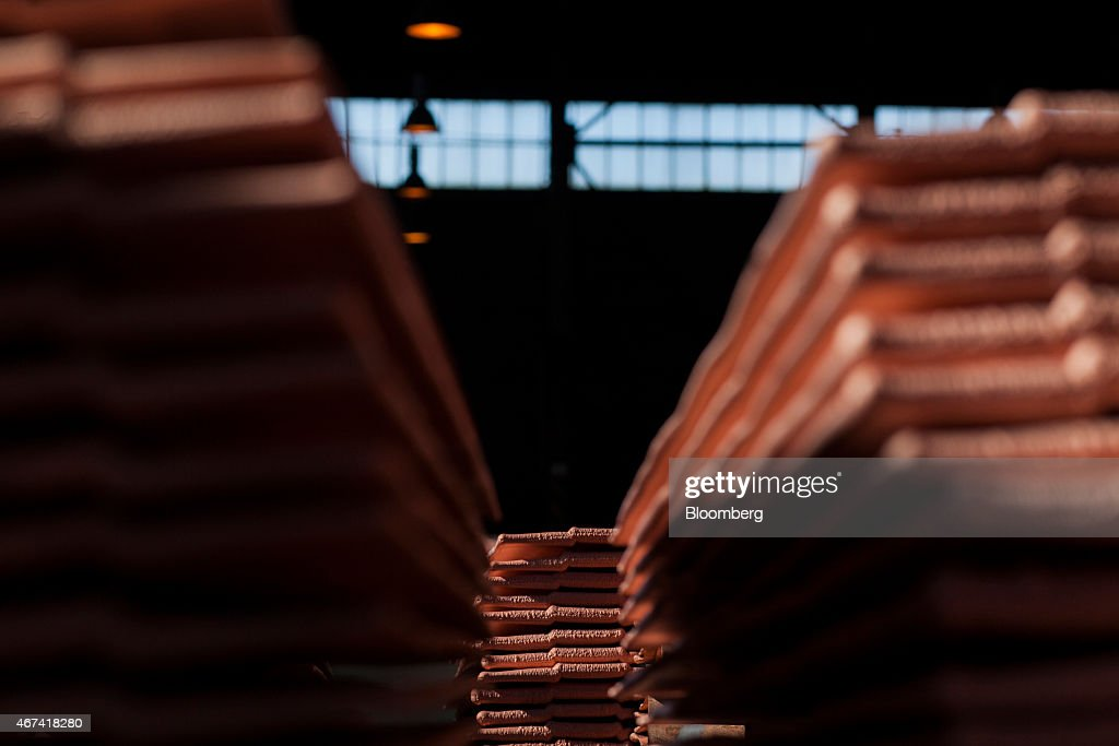 A large collection of newly formed copper cathode sheets sit in a warehouse at the KHGM Polska Miedz SA copper smelting plant in Glogow, Poland, on Monday, March 23, 2015. KGHM is the world's third-largest silver producer behind Fresnillo Plc and BHP Billiton Ltd. Photographer: Bartek Sadowski/Bloomberg via Getty Images