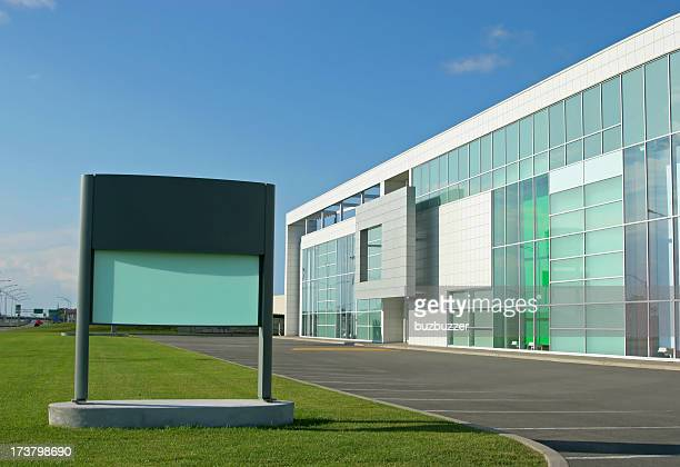 Large commercial building with sign
