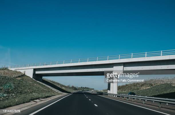 large concrete bridge over a motorway - sky stock pictures, royalty-free photos & images