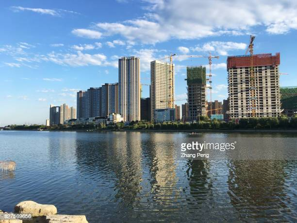 A large construction site beside the Grand canal The amount of real estate transactions in July in the first and second tiered Chinese cities has...