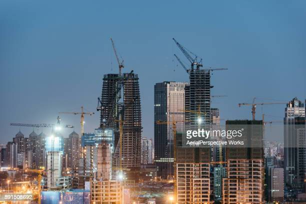 Large Construction Site with Cranes at Dusk, Beijing, China