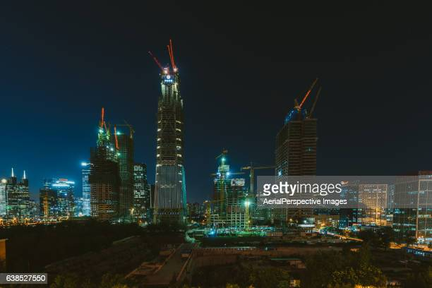 Large Construction Site with Cranes in Beijing CBD Area at Night