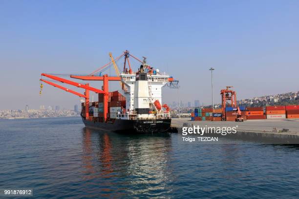 large container ship in a dock at port, haydarpasa - haydarpasa stock photos and pictures