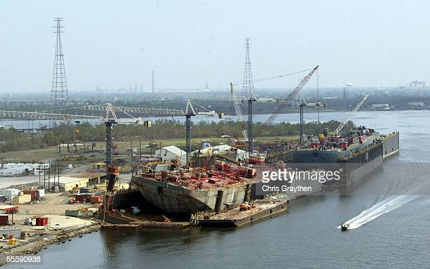 A large container ship rests partially on land after being pushed up off the dock by Hurricane Katrina September 15 2005 in New Orleans Louisiana...