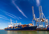 Large container vessel unloaded in Port of Rotterdam