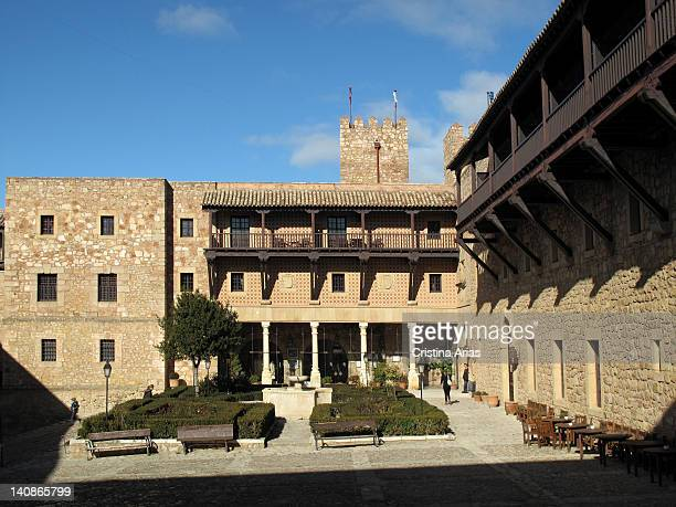 Large courtyard of the castle of Siguenza now a Parador Nacional de Turismo with gateways bearing coats of arms from the 16th century and a wooden...
