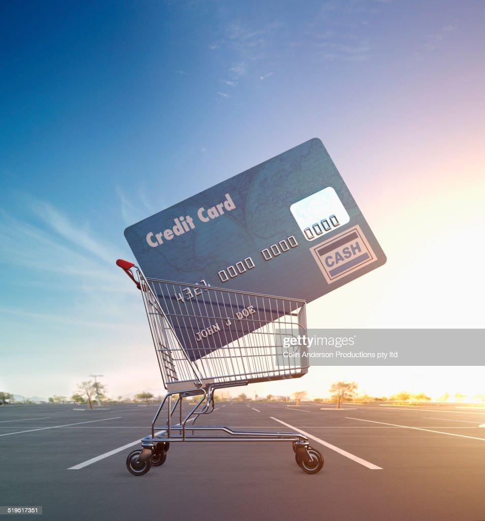 Large credit card in shopping cart in parking lot : Stock Photo
