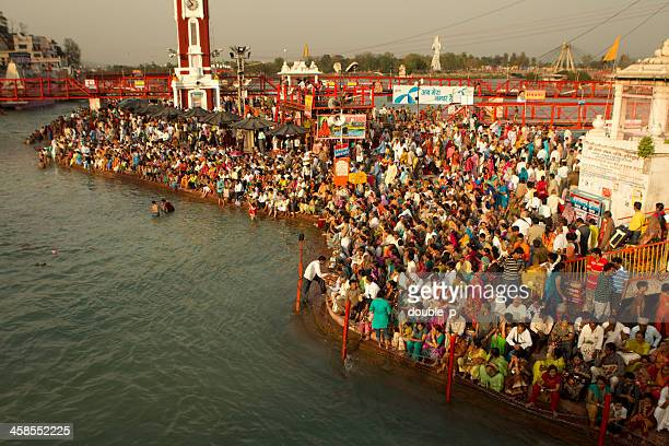 large crowd at ganges in haridwar - haridwar stock pictures, royalty-free photos & images