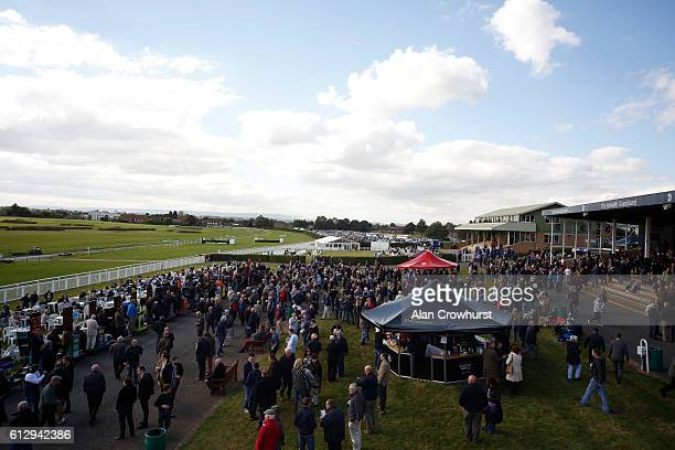 A large crowd at Hereford racecourse on October 6 2016 in Hereford England Hereford today sees a return to jump racing for the first time in four...