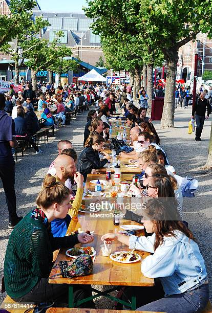 Large crowd eating outdoors