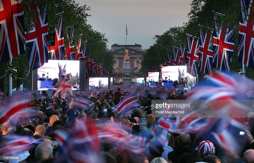 A large crowd fills The Mall in front of Buckingham Palace to watch The Diamond Jubilee Concert on June 4, 2012 in London, England. For only the second time in its history the UK celebrates the Diamond Jubilee of a monarch. Her Majesty Queen Elizabeth II celebrates the 60th anniversary of her ascension to the throne. Thousands of well-wishers from around the world have flocked to London to witness the spectacle of the weekend's celebrations. The Queen along with all members of the royal family will participate in a River Pageant with a flotilla of a 1,000 boats accompanying them down The Thames.