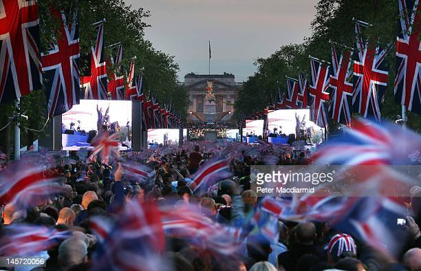 A large crowd fills The Mall in front of Buckingham Palace to watch The Diamond Jubilee Concert on June 4 2012 in London England For only the second...