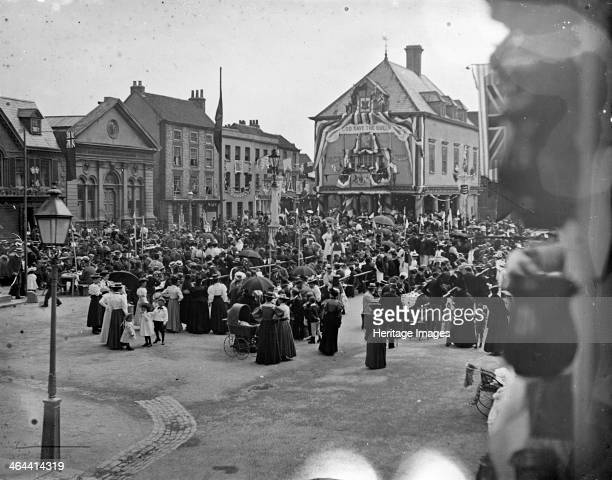 A large crowd gathered in the Market Place Wallingford Oxfordshire during Queen Victoria's jubilee celebrations in 1879