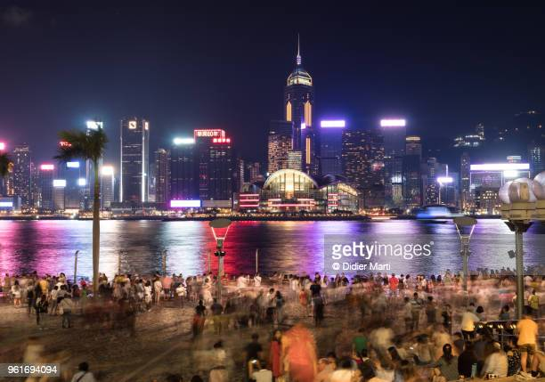Large crowd gathers along the Tsim Sha Tsui waterfront promenade in Kowloon to enjoy the view on Hong Kong island