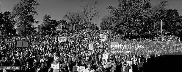 A large crowd gathers in South Boston's Columbus Park to protest federal courtordered busing of black students to allwhite neighborhood schools 1975