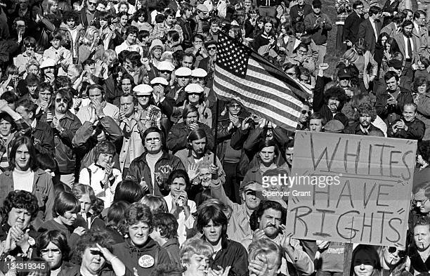 A large crowd gathers in South Boston's Columbus Park to protest federal courtordered busing of black students to allwhite neighborhood schools 1975...