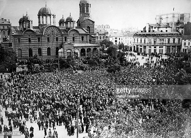 A large crowd gathers in the public square outside the cathedral at Sofia during the 1923 coup d'etat engineered by the military to depose the...