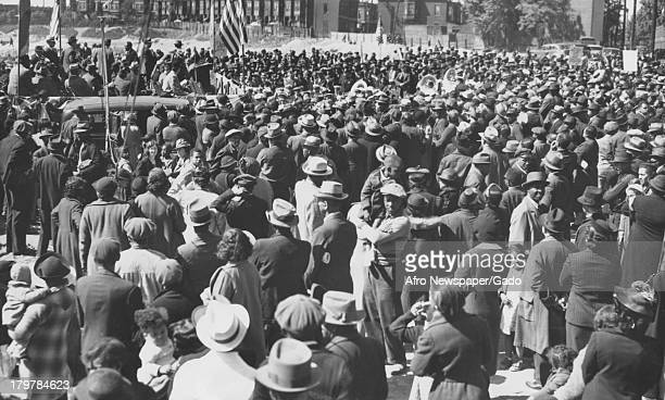 Large crowd gathers to witness the groundbreaking of a new housing project, Philadelphia, Pennsylvania, May 20, 1937.