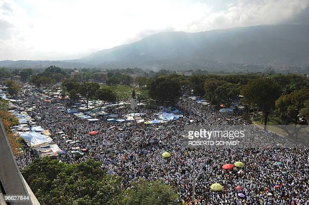 A large crowd of Haitians gather in the streets of downtown PortAuPrince during an outside mass on February 12 2010 a month after a major earthquake...