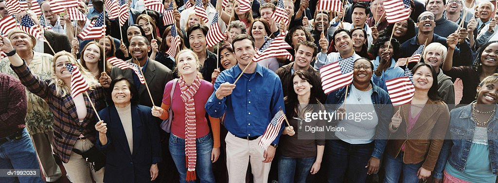 Large Crowd of People Holding Stars and Stripes Flags : Stock Photo