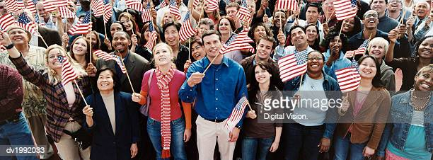 Large Crowd of People Holding Stars and Stripes Flags