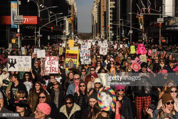 A large crowd of people participating in the Women's March makes its way down 6th Avenue in Manhattan on January 20 2018 in New York City Across the...