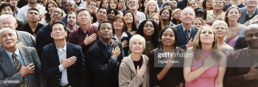 Large Crowd of People Pledging Allegiance : Stock Photo