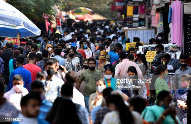 Large crowd of people seen at Sarojini Nagar market on the eve of Karva Chauth festival on November 3, 2020 in New Delhi, India. Karwa Chauth 2020...