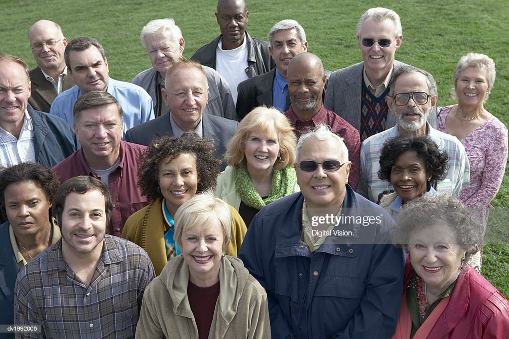 Large Crowd of People Standing Together on Grass : Stock Photo
