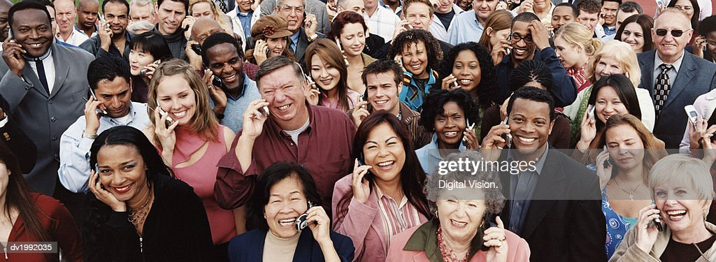 Large Crowd of People Using Mobile Phones : Stock Photo