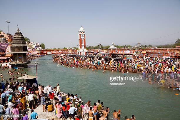 large crowd of pilgrims bathing in ganges for kumbh mela - kumbh mela stock pictures, royalty-free photos & images