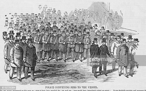 A large crowd of police guard the fugitive slave Thomas Sims as they move him to the docks for extradition to Georgia The mayor of Boston and police...