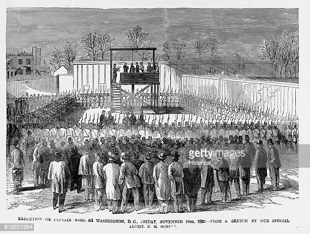 A large crowd of soldiers await the execution by hanging of Henry Wirz the Confederate commandant of Andersonville prison camp on November 10 1865
