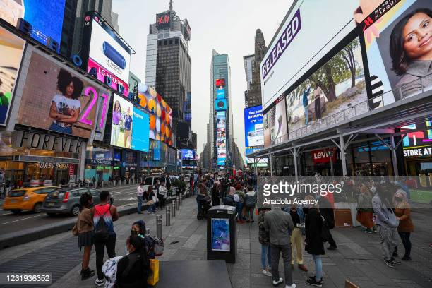 Large crowd of tourists are seen at the Times Square during COVID-19 pandemic in New York City, United States on March 25, 2021.