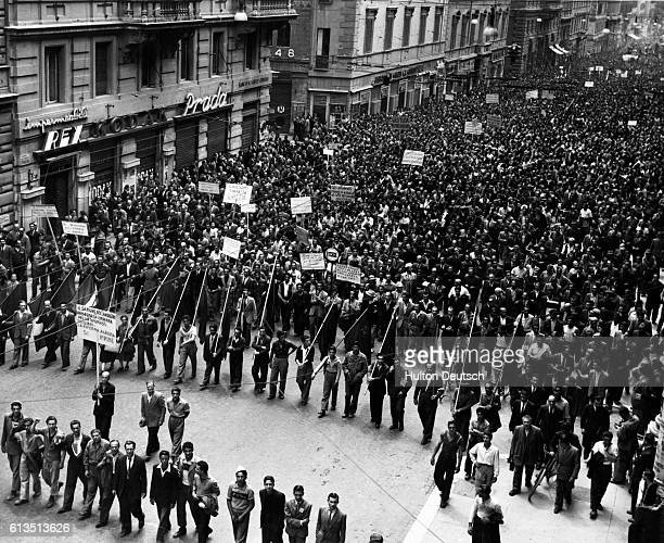 A large crowd of workers down tools for the day and take to the streets of Rome to protest against the May Day killing of eight Sicilian workers May...