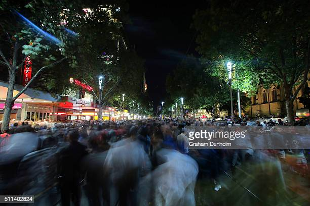 A large crowd packs Swanston Street during White Night Melbourne on February 20 2016 in Melbourne Australia