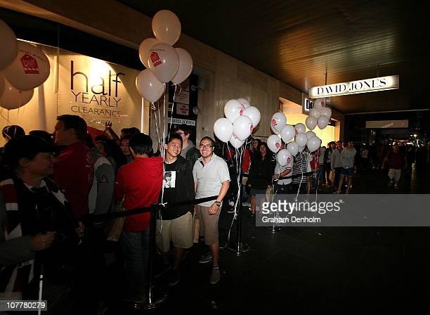 A large crowd queues outside ahead of the David Jones boxing day clearance sale at the Bourke Street Mall flagship store on December 26 2010 in...