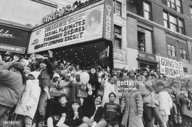 A large crowd waits on the street for the Macy's Thanksgiving Day Parade New York City circa 1984