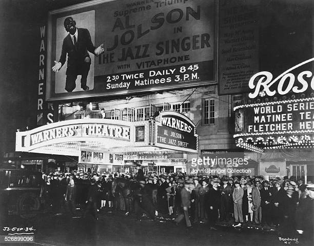 A large crowd waits outside the Warners' Theatre in New York to see Al Jolson in the premier of The Jazz Singer