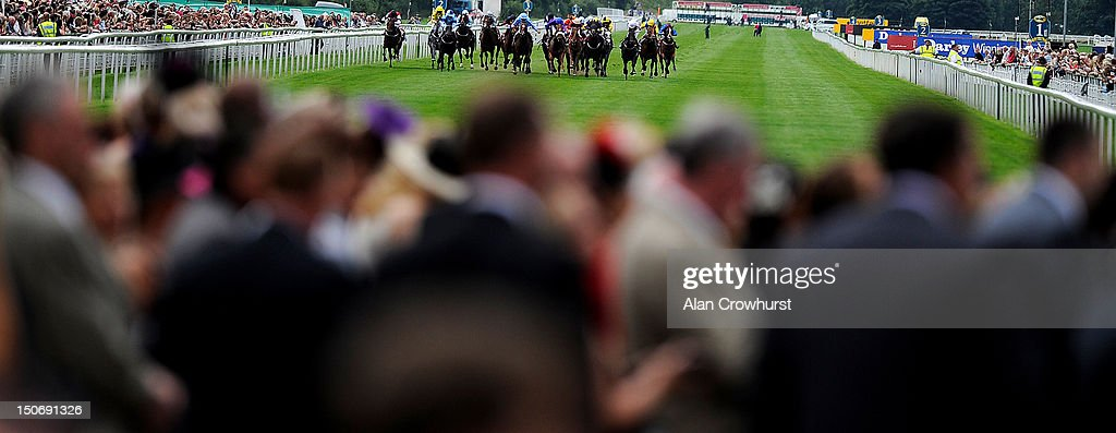 A large crowd watch as the runners make their way to the finish at York racecourse on August 23, 2012 in York, England.